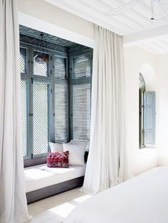 Moroccan bedroom with window seat. Is there a way for the shades to provide insulation in the winter?