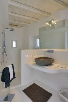 A good version of the white Mykonos bathroom with the painted exposed beams above - want to see if we can have a finish like this or must it be tiled