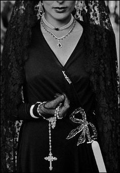 I'm not Catholic, but I absolutely love the classiness of this outfit and the romance of the Spanish mantilla.