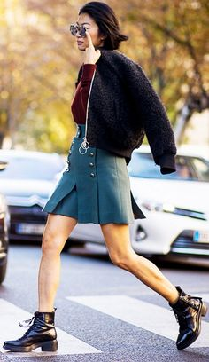 A burgundy sweater is paired with a bomber jacket, miniskirt, and Acne Studios boots