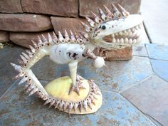 Vintage Seashell Dinosaur Figurine Sea Shell Beach Souvenir Figure T-Rex Art Sculpture by retrosideshow on Etsy https://www.etsy.com/listing/490703359/vintage-seashell-dinosaur-figurine-sea