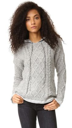 A cozy, cable-knit Generation Love sweater with a fine-knit hood and hem. Long sleeves.
