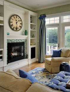 fireplace surround (love the bookcases flanking fireplace and opening, not flush)