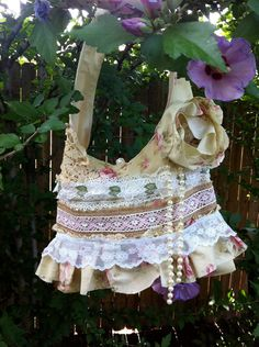 Shabby Chic Ruffle Lace Burlap Purse Tattered Doilies Victorian Pearls. $74.95, via Etsy.