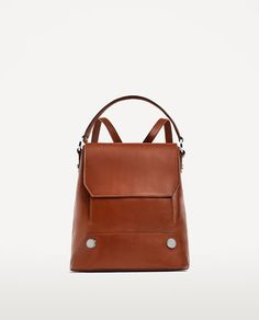 LEATHER BACKPACK WITH BUTTONS