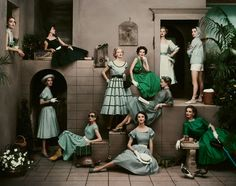 Eleven models in fashions of green and blue, 1952. Photo by Frances McLaughlin-Gill.