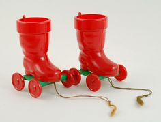 50s Vintage Christmas wheeled candy containers by Rosbro came with candy attached and then could be used as a pull toy.