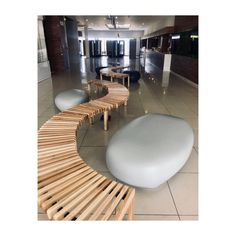 We love both the sculptural interest and relaxed seating option our Contemporary Pebble Seats provide, here shown at the entrance to the new Ad-Corp Head Office. The smooth finish, shown in a mix of Soot and Milkwood pigments, is a great contrast to the curved wooden benches supplied by others. The pebbles come in three designs that also vary in size #igneous_concrete #polyconcrete #concreteseating #pebbleseating #entranceseating #proudlysouthafrican #supportsmallbusiness