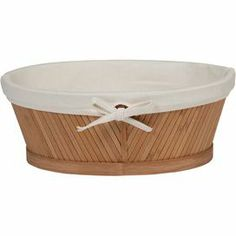 Bamboo vanity basket with removable cotton liner.      Product: BasketConstruction Material: Bamboo and cottonColor: Natural Features: Removable cotton liner Dimensions: 9.6 H x 15 W x 14 D