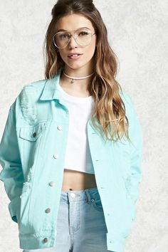 A denim jacket featuring a distressed design, button front, button flap pockets, a basic collar, long sleeves with button cuffs, slanted baste-stitch pockets, and a boxy silhouette.