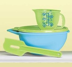 """Children's Baking Set by Tupperware. $29.99. Here's a 3-piece set of adorable children's products that lets children discover the joys of baking - whether making something for real with mom or """"just pretend"""" with their friends. Everything in this set is made just like a regular, full-scale Tupperware® product, except that it's scaled for smaller hands. Imagine just how much fun your kids or grandkids will have with these delightful baker's tools. Color choice may be sub..."""