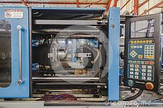 Plastic molding injection machine with the tool die mold open after plastic product is ejected.