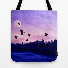 Crow moon Tote Bag by Pirmin Nohr - $22.00 A flock of crows flying through a foggy valley at dawn. That tower on the mountain is a castle ruin. A photomontage of 4 of my pics.   Nature, landscape, valley, silhouettes, fog, castle ruin, sky, clouds, red, blue, black, mystical, birds, animals, fullmoon, moon