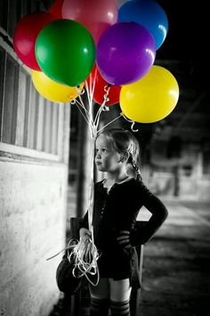 I really like this picture because it's a classic color selection picture.  The focus is amazing and the eyes are drawn from the girls to the balloons.  I really like all of the playful, girly colors that tell a story behind the picture.