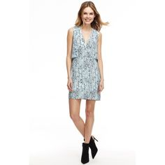 Featuring a subtly cropped layer and Modern Snake Print, The Grace Dress is going to be your new date night go-to.