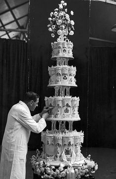 Queen Elizabeth's Wedding, 1947.  Bride's Magazine:Princess Elizabeth & Duke of Edinburg.One foot shy of her parents' cake, the then-Princess's four-tiered wedding cake was created by McVitie & Price, Ltd. & featured sugar figurines depicting the couple engaging in favorite pastimes together. Slices were cut using the Duke's sword & one layer was preserved for Prince Charles's christening in 1948. http://www.brides.com/celebrity-wedding/royal-wedding/2011/04/real-royal-wedding-cakes#slide=4