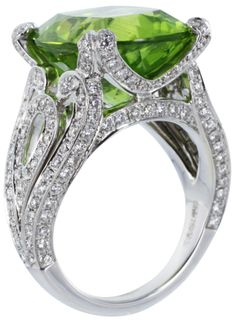 Garrard of London Peridot Diamond Cocktail Ring. Estate Garrard London 18 karat white gold cocktail ring from the Regal Collection consisting of 1 cushion cut peridot weighing approximately carats and accented by pave set round brilliant cut diamonds. Jewelry Rings, Jewelry Accessories, Fine Jewelry, Jewelry Design, Jewellery, Ringa Linga, Peridot Jewelry, Peridot Rings, Gemstone Rings