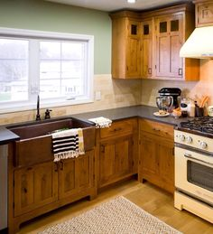 HGTV has inspirational pictures ideas and expert tips on Shaker kitchen cabinets that can add style to either a traditional or modern home. & A bone white undermount composite sink complements the appliances ...