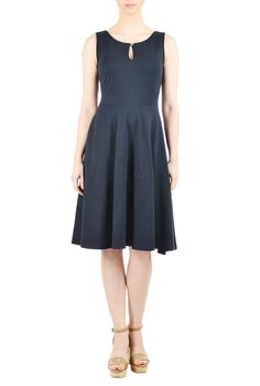 A soft cotton knit covers our fit-and-flare dress styled with a keyhole neckline and full flared skirt.