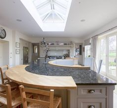 The island - whether dining or sitting at the breakfast bar with the morning papers and a coffee, is a wonderful place to be with plenty of light from the glazed ceiling arrangement and the French doors with views of the garden.