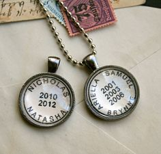 Custom Names & Dates Necklace in vintage postmark style, by CrowBiz on Etsy.  Also available in keychains.