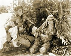 1921: Rudolph Valentino and Agnes Ayres in The Sheik.  Inspires pseudo-Arab fashion, and brides wear Shiek-inspired veils for the next 20 years.