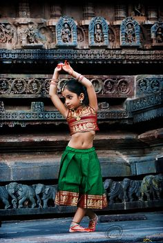 Aarti is 5 years old. She practices Indian dances that her mother has taught her.