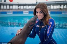 Beauty: Gessica, 28, pictured at an acquarium where she worked, alleges that her former bo...