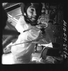 """AS13-59-8484 (1.2 Mb) Jim Lovell in the LM, preparing it for jettison. Journal Contributor Mike Poliszuk notes that the DSKY display, visible to the right of Jim's elbow, shows """"his computer is in 'Poo', i.e. Program 00, idling. It is powered on but not doing anything..."""