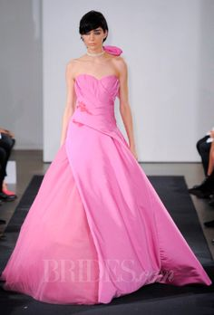 Brides.com: Vera Wang - Fall 2014. Peony strapless faille ball gown wedding dress with hand draped bodice and coral floral beaded embroidery, Vera Wang