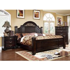This three piece bed set features beautiful dark walnut finishes that accentuate the shining hardware and open floral design found along the oval headboard. Fluted posts create a sturdy visual that is sure to look sophisticated in any setting!