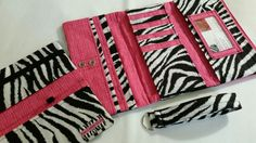 10% off with code SAVETEN ends 10/31! Start your holiday shopping early! Maybe this fantastic #trifold #wallet in #zebra and #pink? Or matching checkbook and key fob? #women #accessories #wallets Custom made in your choice of fabrics! Visit www.eyecandyquilting.com!