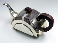 Art Deco bakelite and white metal teapot, circa 1930.