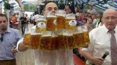 A German waiter has broken a world record by carrying 27 full mugs of Bavarian beer.