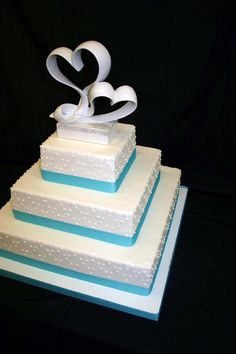 Simple light blue and white wedding cake (I wouldn't mind this for my own wedding one day)