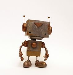 This is Beta Bob. He lives with me. Check out forgotten robots on etsy.