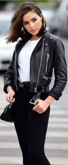 Who made Olivia Culpo's gold belt and black leather jacket?