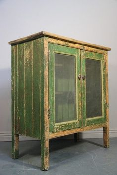 green antique pie safe                    I think I could make something close to this I have board and 2 screen doors.