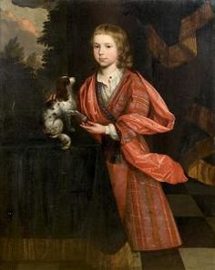 Attributed to Thomas Hill (1661-1734 Mitcham) Portrait of a young boy, three-quarter-length, in red costume, with a King Charles spaniel at his side, standing before a landscape oil on canvas
