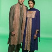 A kurta is a traditional, loose-fitting, long tunic worn by men and women in Asia and the Middle East. It is generally worn over a pair of loose-fitting pants. Kurtas are simple garments, consisting of a front, back and sleeves. In the absence of a sewing pattern, you can use an old T-shirt, that loosely fits the person, as the basis for a pattern...