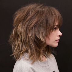 Medium Messy Shag with Arched Bangs Amp up volume of medium shag haircuts with a texturizing spray for a messy vibe. The organized chaos of the cut and arched bangs that make eyes pop will… Medium Hair Cuts, Medium Hair Styles, Curly Hair Styles, Bangs Medium Hair, Medium Layered Hair, Medium Shag Haircuts, Haircuts With Bangs, Haircut Medium, Best Haircuts