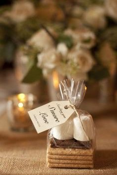 Smores wedding favor- pinned one already,   but I couldn't find it in all pins :) cheers to a s'mores bar at our wedding and   making s'mores for each other in lieu of cake! Solo, wanted to do   this!!
