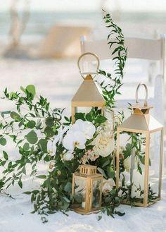 gold lantern wedding aisle decoration ideas with greenery #weddinginspiration #weddingcolors #greenwedding #goldwedding #weddingideas