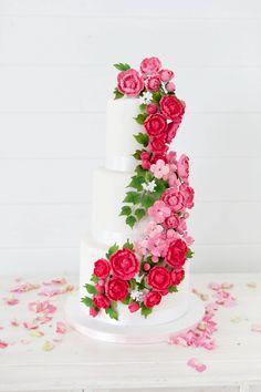 Wedding cake with cascading sugar flowers | Corette Faux