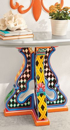 A bold, handpainted table with unexpected designs. Our Gia Console Table is lightweight, completely outdoor safe, and virtually maintenance free.