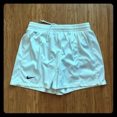 White Nike Shorts White Nike soccer/athletic shorts. Worn once and in good condition. A couple of tiny dot sized marks shown in pictures 2 and 3. Size medium, see second picture for fit (for reference, I'm generally always a medium in Nike shorts). Feel free to make an offer! Nike Shorts