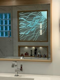 """Jellyfish detail sandcarved into 1/2"""" starphire glass, installed with LED edge lighting"""