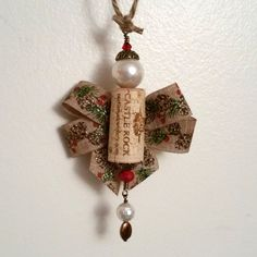 Wine cork angel with Pine cone ribbon Handmade by OuLaLaWineGifts Wine Cork Ornaments, Christmas Ornaments, Pine Cones, Ribbon, Angel, Entertaining, Holidays, Holiday Decor, Unique Jewelry