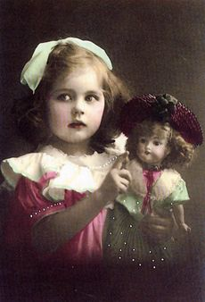 Vintage colour photo of girl and doll