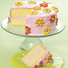 Easter Spring Cake - Add red food coloring to store-bought vanilla icing to make pink frosting. Candy-coated treats are an easy way to finish this festive cake.